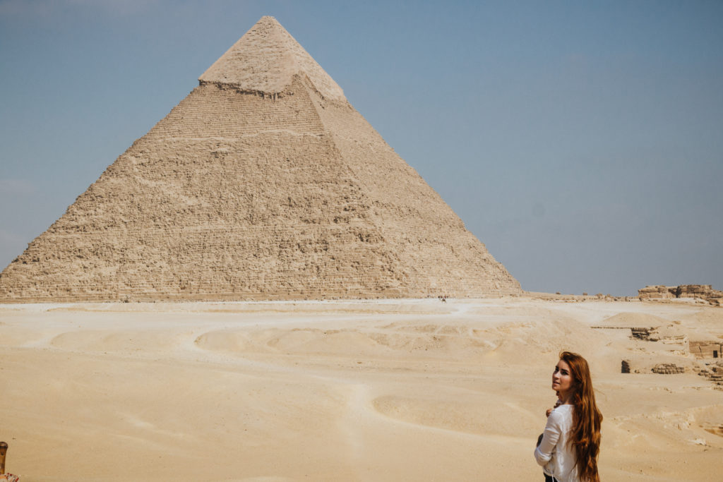 Standing in front of the pyramids