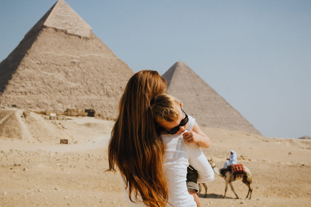 Visiting the pyramids and camels in the background